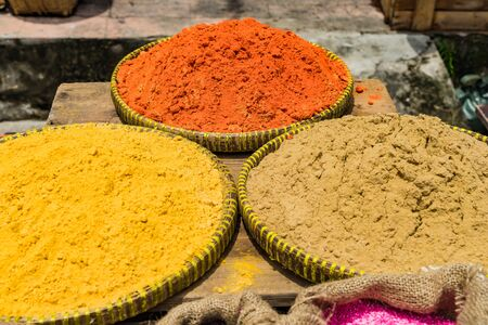 View of Turmeric powder on the trays in the market