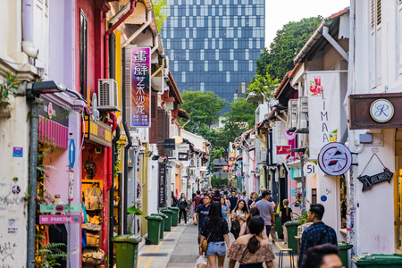 Singapore - September 2, 2017: Visitors walk around the street Haji Lane well known as Street arts and fashionable location for youth people and tourists in Singapore