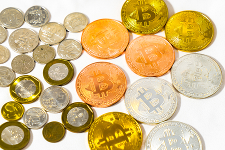 Singapore Dollar coins and Bitcoin Cryptocurrency coins on White background, Golden Silver and Bronze coins Isolated