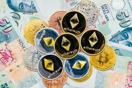 Bitcoin Cryptocurrency and Ethereum coins on top of Singapore Dollar banknotes, The Singapore dollar is the official currency of Singapore, Concept Virtual Currency over the current currency