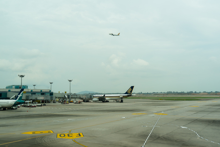 Singapore - January 6, 2018: Airplane ready to take off at Changi International Airport. Departure Hall Singapore, it is one of the largest transportation hubs in Asia