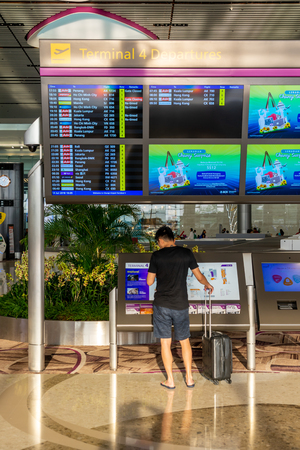 Singapore - July 14, 2018: Departure Board in Changi Airport. Departure Hall Singapore. It has 4 passenger terminals, and it is one of the largest transportation hubs in Asia Publikacyjne