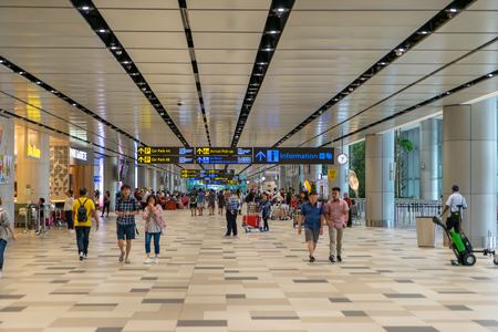 Singapore - Julyy 14, 2018: Visitors walk around Departure Hall in Changi Airport. It has 4 passenger terminals, one of the largest transportation hubs in Asia and serves more than 100 airlines