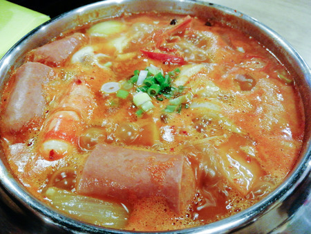 Delicious Korean food Yukgaejang spicy seafood soup, Yukgaejang Hot pot is Korean stew made with kimchi, noodles, ham, sausage, mussels, prawn and vegetables