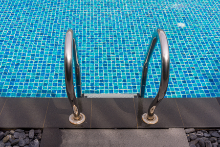Beautiful luxury swimming pool with clear water on sunny day and Pool stair