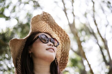Nice Asian woman standing in a park potrait head shot Stock Photo