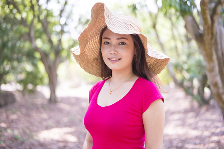 Asian women smiling and  happy  feeling in the garden