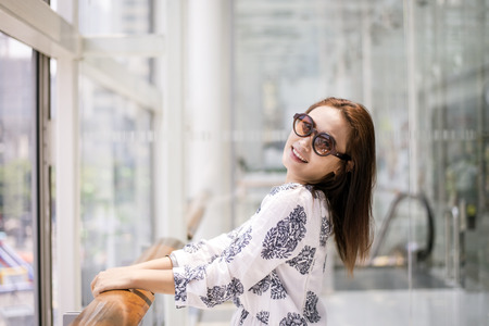 Beautiful young woman smiling and happy in shopping center