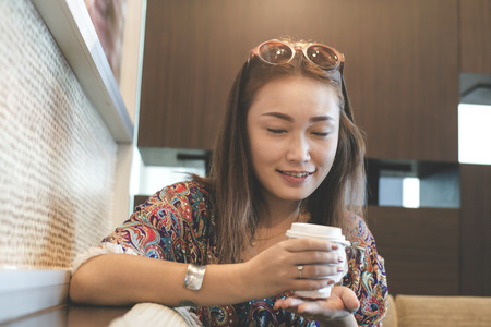 Asian women happy with aroma of coffeefiltered Stock Photo