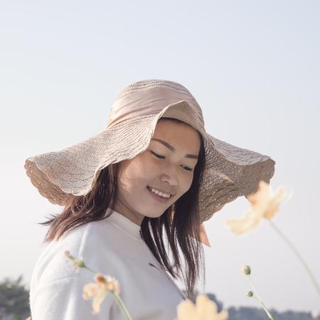 Asian girl smiling in the flower garden Stock Photo