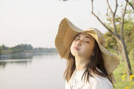 Asian girl feeling happy on sunset