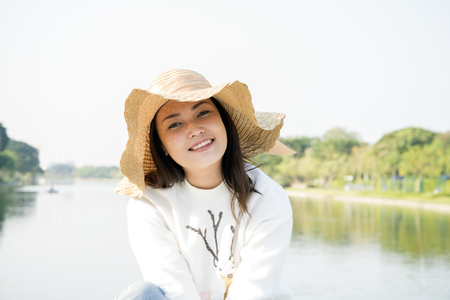 Asian girl feeling happy  at the lake