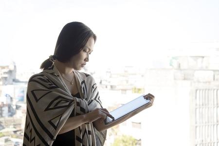 Asian women portrait using a tablet computer