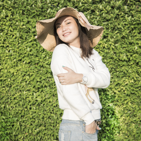 Asian girl smiling in the garden