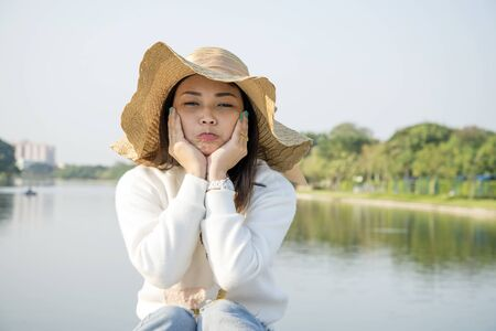 Portrait of nice Asian girl at lake photo