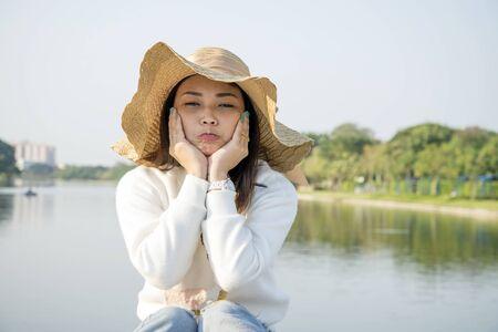 Portrait of nice Asian girl at lake