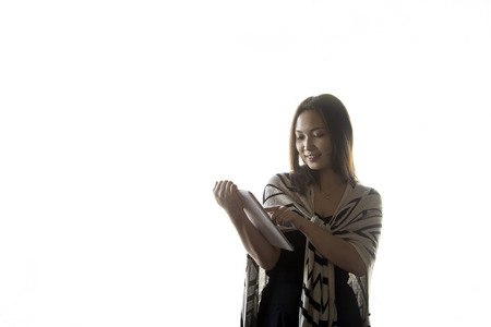 Asian women portrait using a tablet computer on white background