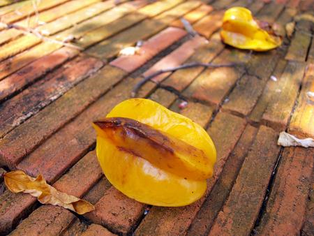 fruit drop: Star fruit drop on brick