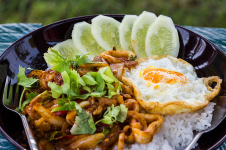 seafood Curry fried rice with fried egg. photo