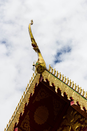 Thai dragon or king of Naga statue at the eaves of monastery in Thai temple photo