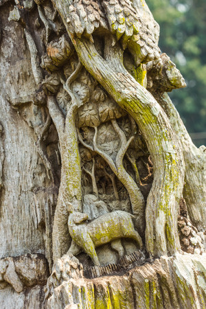 wood carve about deer in forest at public temple
