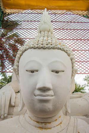 Head of white buddha  statue in public temple north Thiland