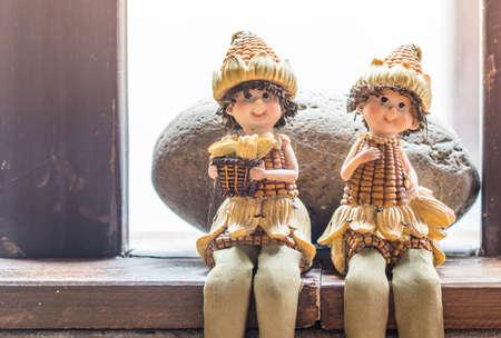 cute doll wearing a corn costume in the park Standard-Bild