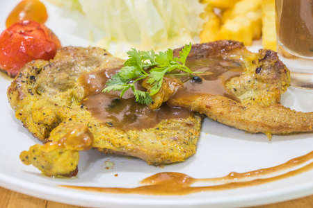 yummy pork steak on white dish