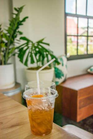 Ice peach tea on wood table