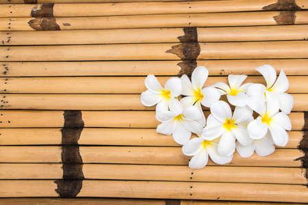 cute frangipani on bamboo desk