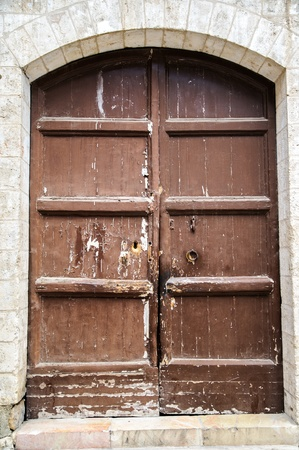 The wooden door on the old walls in Jerusalem Stock Photo - 14329825