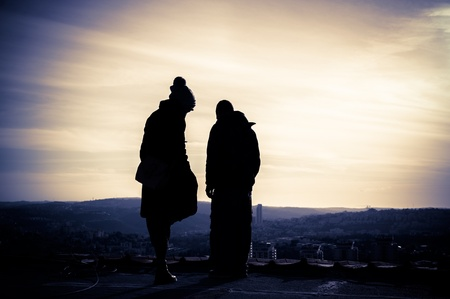 Silhouette of young couple on the rooftop at sunset Stock Photo - 14384150