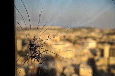 Broken window,  cracked glass on urbanic background