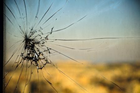 Broken window,  cracked glass on urbanic background Stock Photo - 14458848