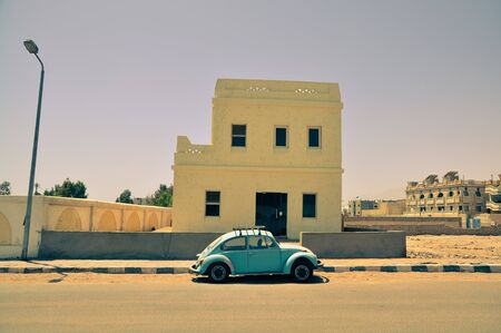 Classic Beetle car in the street of Egyptian town Stock Photo - 14597454