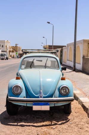 Classic car in the street of Egyptian town