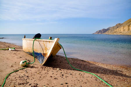 Old fisherman boat at the beach. Panorama photo