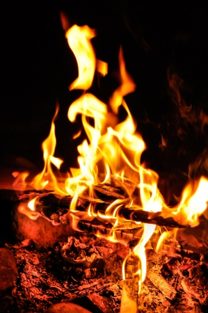 Background of flames and glowing embers in a Campfire Stock Photo