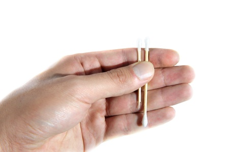 predicted: Hand is holding earsticks  draw lots on white background Stock Photo