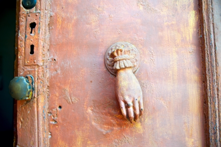 close up of female hand old doorknocker Stock Photo - 16422824