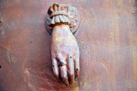 close up of female hand old doorknocker