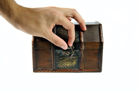 Hand is closing wooden chest isolated on white background Stock Photo - 17004305
