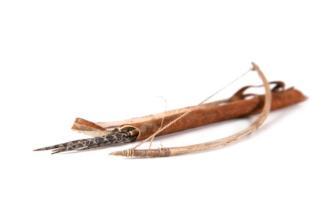 Old decorative bow, quiver and arrow on the white background