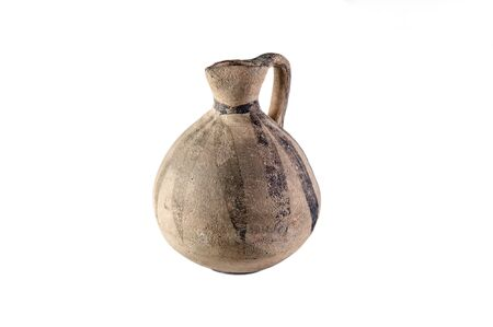 Clay old Middle Eastern jug on the white background Stock Photo