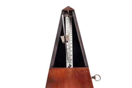 Vintage wooden metronome music timer on the white background photo