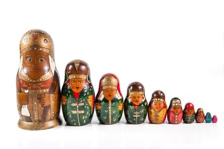 A row of an antique wooden matrioshka dolls