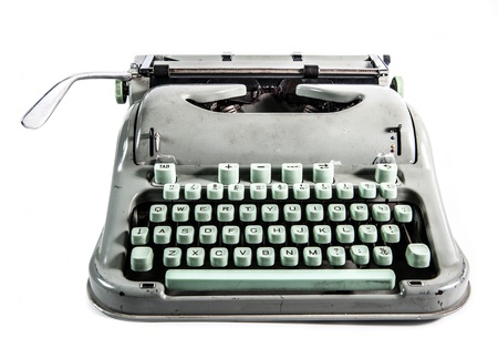 typewriter: M�quina de escribir retro estilo grunge en el fondo blanco Foto de archivo