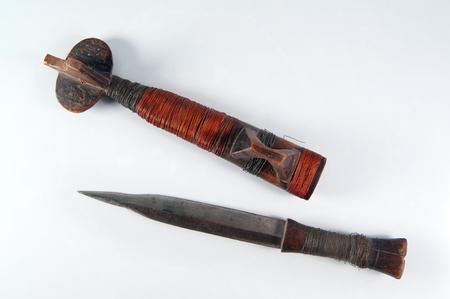 Mozambique traditional ancient dagger with a sheath, isolated Stock Photo - 18130228
