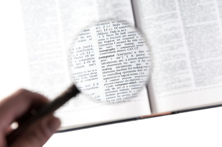 A magnifying glass on the word computer on a dictionary Stock Photo