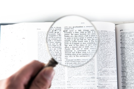 A magnifying glass on the word goal on a dictionary Stock Photo - 18656976